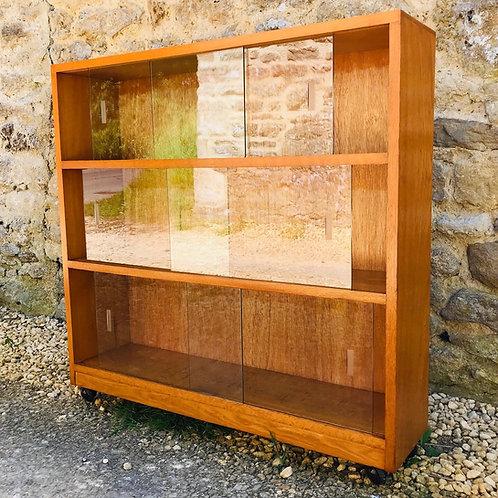 Mid 20thCentury bookcase in light Oak.