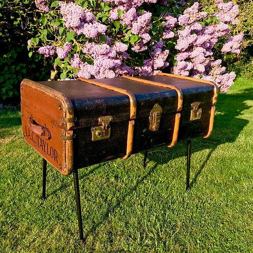 Repurposed vintage travel trunk lamp table