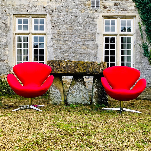 Pair of Modernist armchairs in the style of the Swan Chair by Arne Jacobsen.
