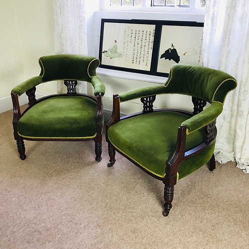 Pair of Edwardian mahogany fireside / library armchairs.
