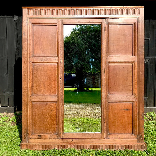 Antique carved hall cloaks cupboard in English Oak