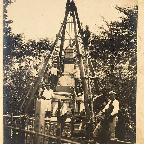 Early 20thC photo of Japanese workers erecting stone monument
