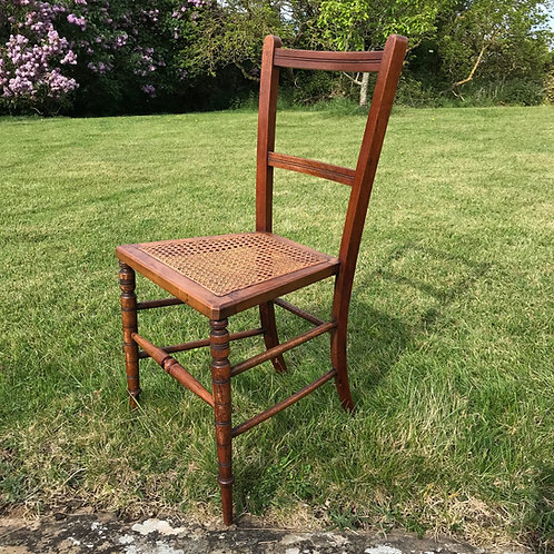 Antique oak cane seat chair with turned front legs - small format