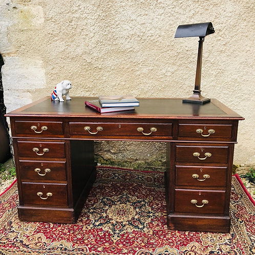Early 20thC twin pedestal mahogany desk.
