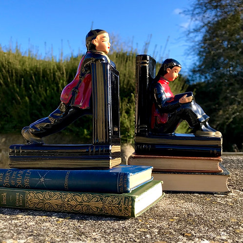 1950's Chinese acrobat bookends in porcelain.