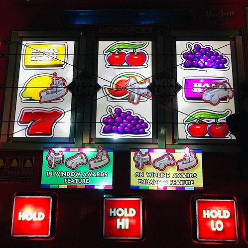 Vintage Monopoly slot/fruit machine illuminated wall art.