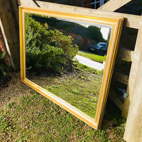 Ornate large format gilt mirror with heavy moulding.