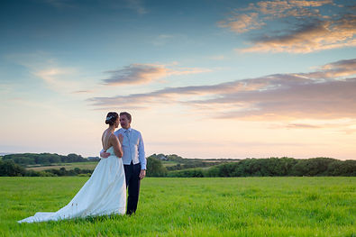 newly weds at sunset field in West Wales