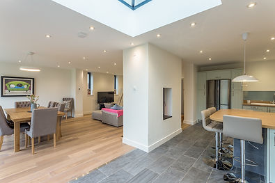 Modern open plan kitchen and living room in Cheltenham