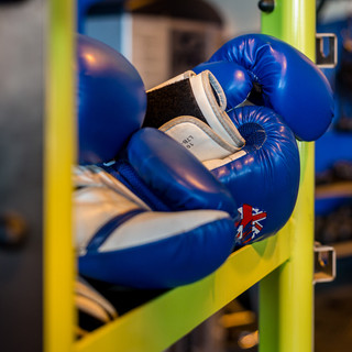 stack of blue boxing mitts