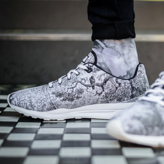 patterned trainers on tiled floor