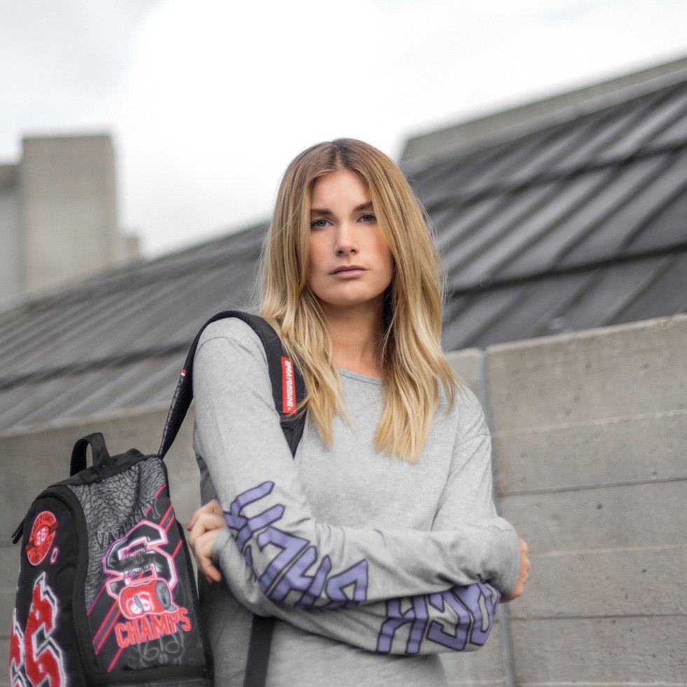 blonde female model with rucksack at Southbank London