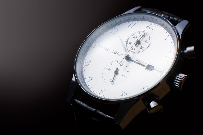 professional watch edited against dark background