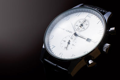 professional watch edited against dark background