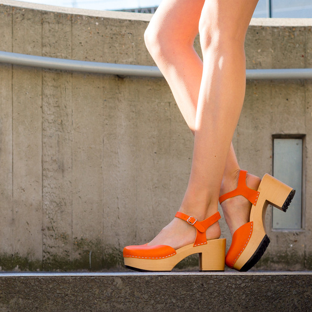 long toned legs in orange heels