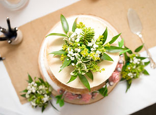 wedding cake adorned with flowers to match bouquet