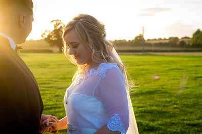 Bride and Groom at sunset Over Farm Chelteham