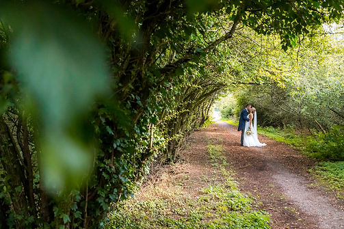 young bride and groom in wooded canopy