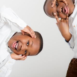 brothers playfully posing in home studio Cheltenham
