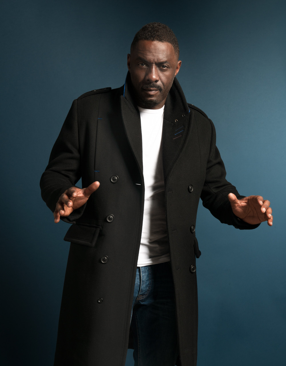 Idris Elba hollywood actor modelling for Superdry against a navy blue background