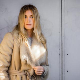 blonde model in faux fur coat