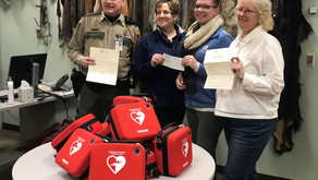 DNR conservation officers receive funds for lifesaving AEDS
