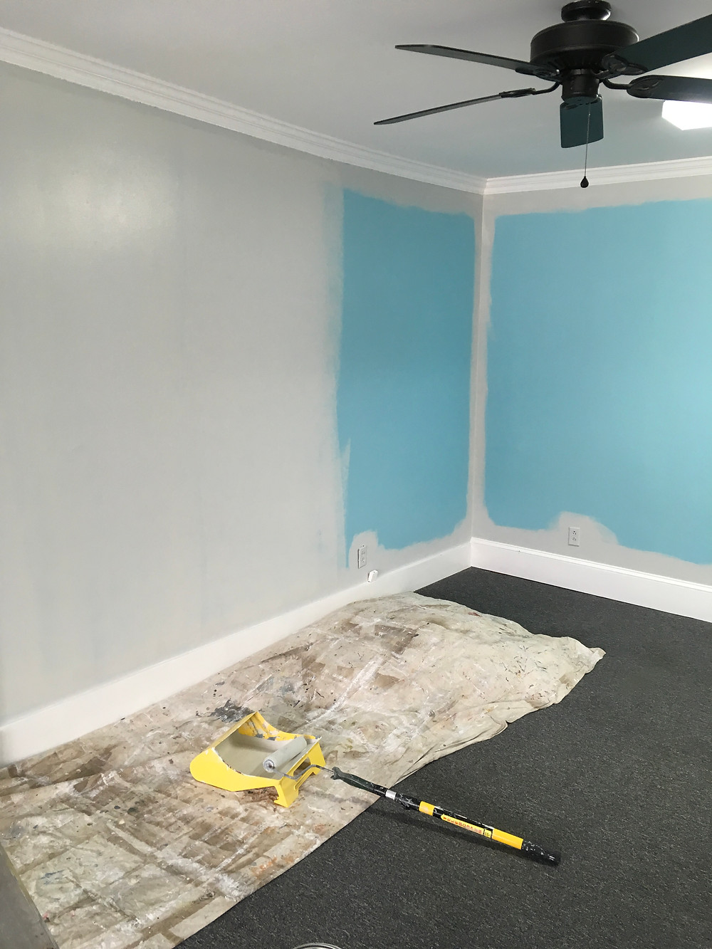Interior walls of new studio in the process of being painted