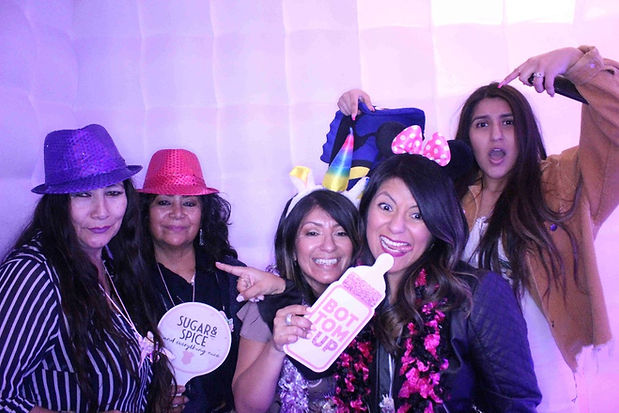 Group Of Women Posing Inside A Photo Booth Rental