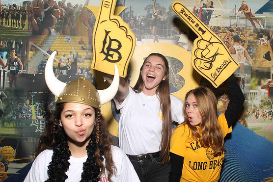 College Students Posing At A Photo Booth Rental With Long Beach State Gear