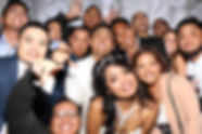A Group Of Friends Posing With Newlywed Couple For The Photo Booth Rental