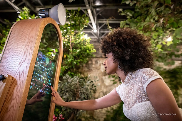 Woman Using Rustic Magic Mirror Photo Booth Experience At A Wedding