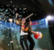 Two Women Throwing Confetti & Posing On 360 Video Spinner Photo Booth Rental