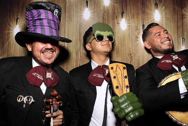 Three Men Dressed As Mariachi Band Pose With Photo Booth Props For Photo Booth Rental