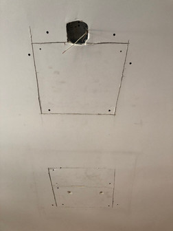 Drywall holes cut for new lighting