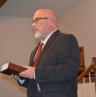 Brother Rusty trial sermon holding Bible