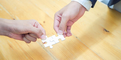 person-holding-white-jigsaw-puzzle-piece