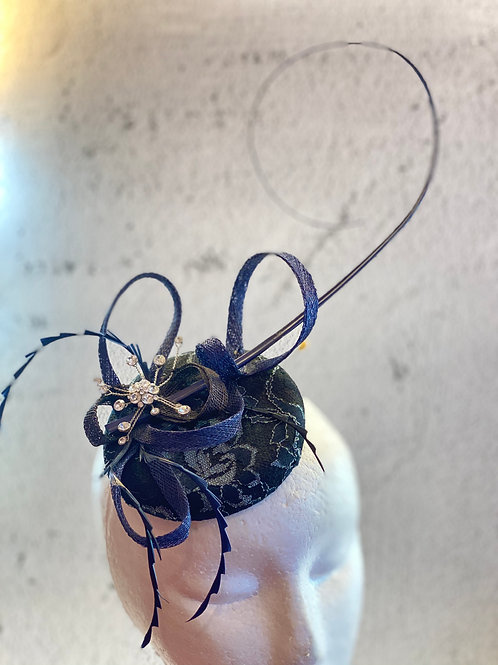 Dark blue felt hat with lace and feather