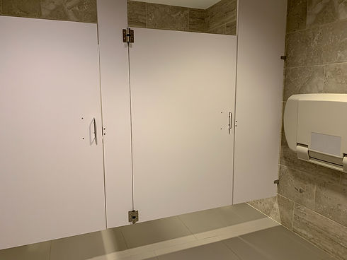 View of floating bathroom stall in publi
