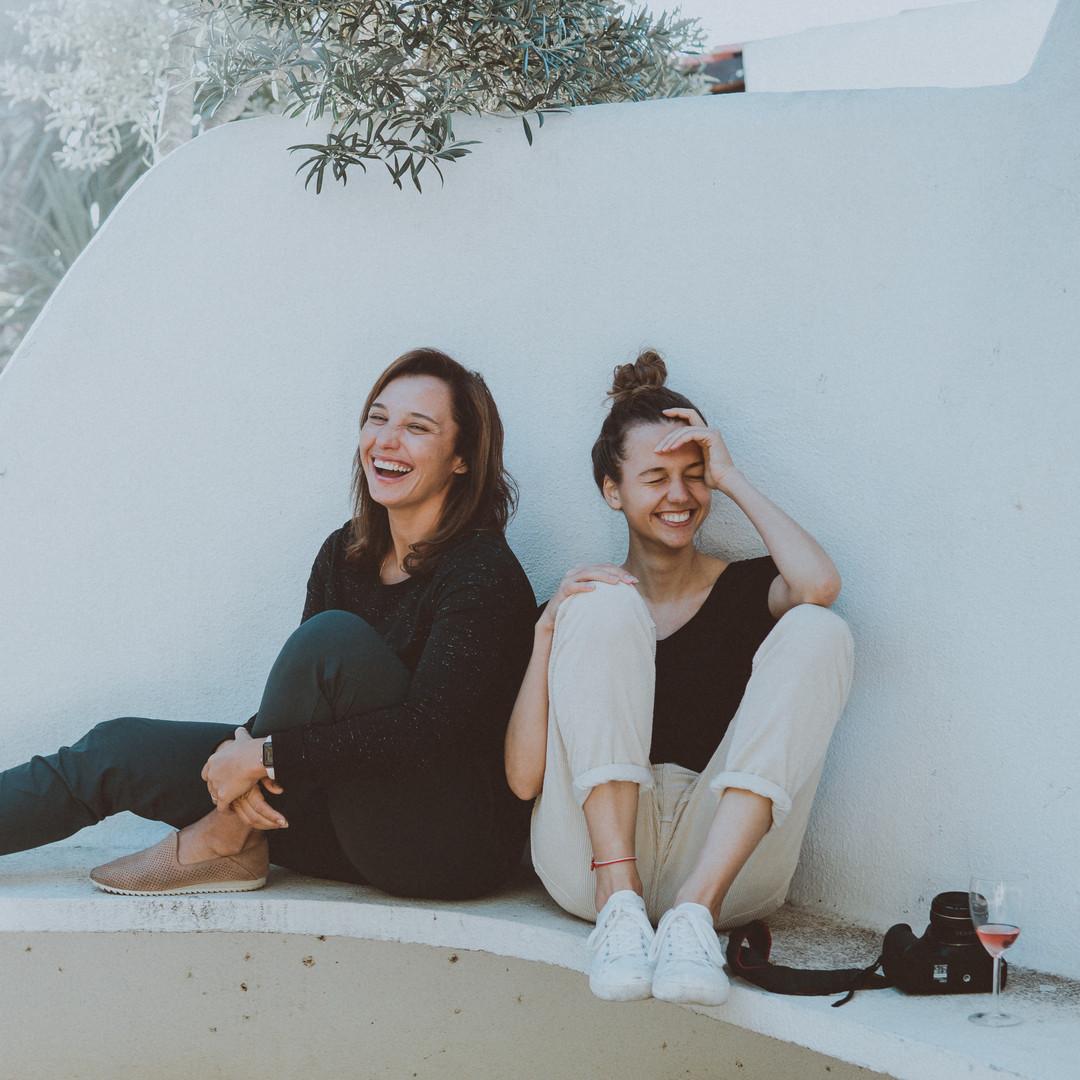 two-women-sitting-on-white-bench-1549280