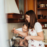mother-and-child-preparing-crepes-380736