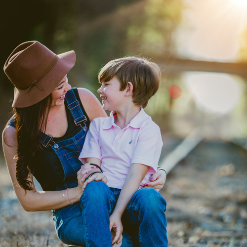 mother-and-son-seated-on-railway-tracks-