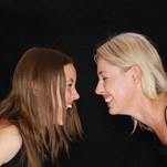 2-women-smiling-near-black-textile-35024