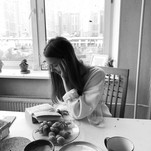 grayscale-photography-of-woman-reading-b