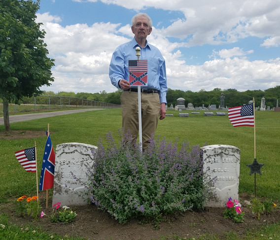 Douglas Whaley at the graves of Frank Chick and Nicholas Brill, 'the turkey men.'