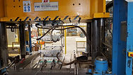 Hydraulic press in open position.