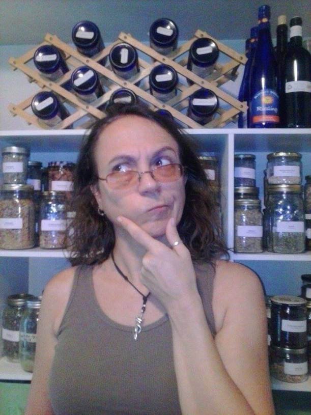 Woman standing in front of an herbal apothecary, looking thoughtful