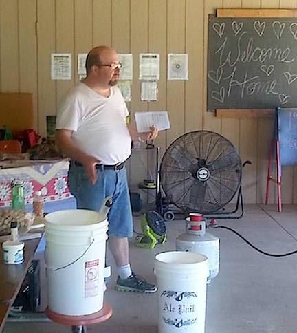 man demonstrating soap making