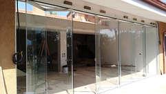 Vetrate pieghevoli tutto vetro frangivento SLIDE