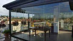 Vetrate panoramiche frangivento tutto vetro