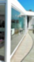 Pergola su terrazzo con vetrata panoramica a pacchetto